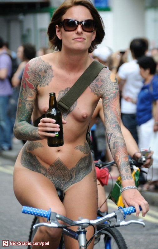 Tattooed Beer Drinking Nude Bicyclist In Public
